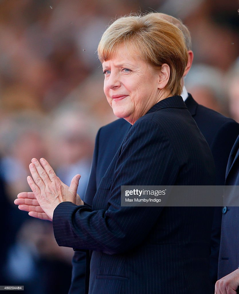 German Chancellor <a gi-track='captionPersonalityLinkClicked' href=/galleries/search?phrase=Angela+Merkel&family=editorial&specificpeople=202161 ng-click='$event.stopPropagation()'>Angela Merkel</a> attends the International Ceremony at Sword Beach to commemorate the 70th anniversary of the D-Day landings on June 6, 2014 in Ouistreham, France. Friday 6th June is the 70th anniversary of the D-Day landings which saw 156,000 troops from the allied countries including the United Kingdom and the United States join forces to launch an audacious attack on the beaches of Normandy, these assaults are credited with the eventual defeat of Nazi Germany. A series of events commemorating the 70th anniversary are planned for the week with many heads of state travelling to the famous beaches to pay their respects to those who lost their lives.