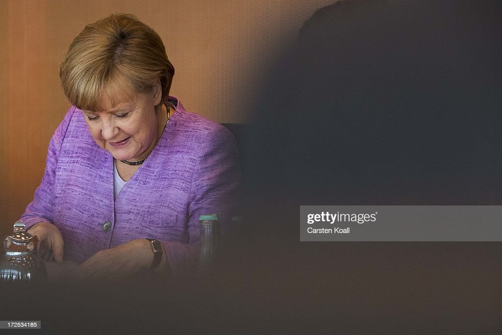 German Chancellor <a gi-track='captionPersonalityLinkClicked' href=/galleries/search?phrase=Angela+Merkel&family=editorial&specificpeople=202161 ng-click='$event.stopPropagation()'>Angela Merkel</a> attends the weekly cabinet meeting at the Chancellery (Bundeskanzleramt) on July 3, 2013 in Berlin, Germany.