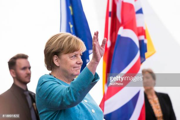 German Chancellor Angela Merkel awaits for the arrival of Britain's Prince William Duke of Cambridge and his wife Kate the Duchess of Cambridge at...