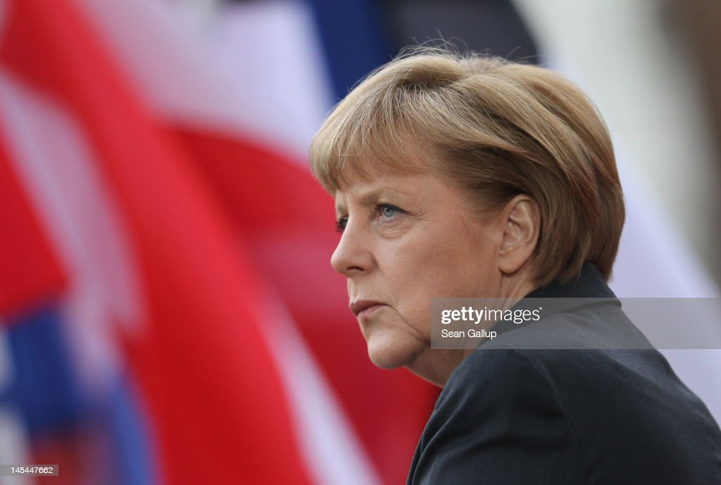 German Chancellor <a gi-track='captionPersonalityLinkClicked' href=/galleries/search?phrase=Angela+Merkel&family=editorial&specificpeople=202161 ng-click='$event.stopPropagation()'>Angela Merkel</a> awaits the arrival of heads of state at the 2012 Council of Baltic Sea States Summit on May 30, 2012 in Stralsund, Germany. Leaders of the eleven member states as well as representatives of the European Union are meeting to discuss matters related to energy, the environment and economic development during the two-day summit.
