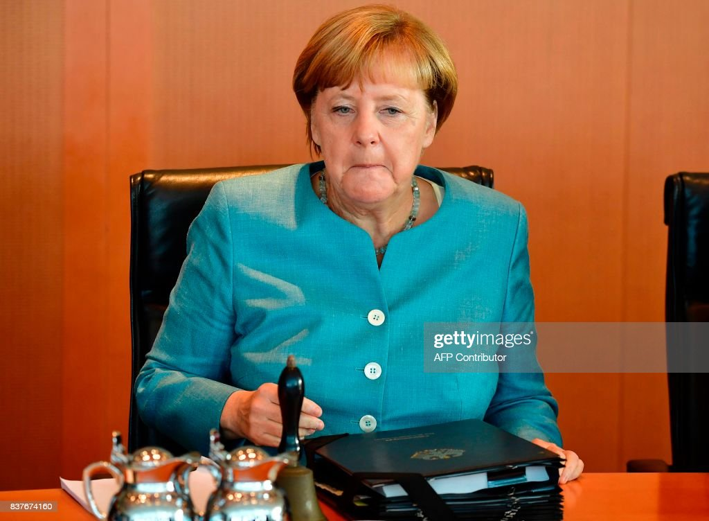 German Chancellor Angela Merkel awaits the start of the weekly cabinet meeting in Berlin, on August 23, 2017. /