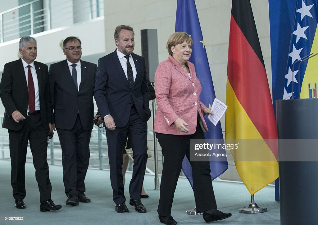 German Chancellor Angela Merkel (R) Bosniak Member of the Presidency of Bosnia and Herzegovina Bakir Izetbegovic (2nd R), Serbian Member of the Presidency of Bosnia and Herzegovina Mladen Ivanic (2nd L) and Croat Member of the Presidency of Bosnia and Herzegovina Dragan Covic (L) arrive for a press conference following their meeting at the Federal Chancellery in Berlin, Germany on June 30, 2016.