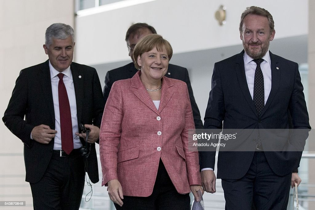 German Chancellor Angela Merkel (C) Bosniak Member of the Presidency of Bosnia and Herzegovina Bakir Izetbegovic (R), Serbian Member of the Presidency of Bosnia and Herzegovina Mladen Ivanic (rear) and Croat Member of the Presidency of Bosnia and Herzegovina Dragan Covic (L) arrive for a press conference following their meeting at the Federal Chancellery in Berlin, Germany on June 30, 2016.