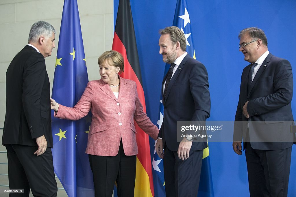German Chancellor Angela Merkel (2nd L) Bosniak Member of the Presidency of Bosnia and Herzegovina Bakir Izetbegovic (2nd R), Serbian Member of the Presidency of Bosnia and Herzegovina Mladen Ivanic (R) and Croat Member of the Presidency of Bosnia and Herzegovina Dragan Covic (L) arrive for a press conference following their meeting at the Federal Chancellery in Berlin, Germany on June 30, 2016.