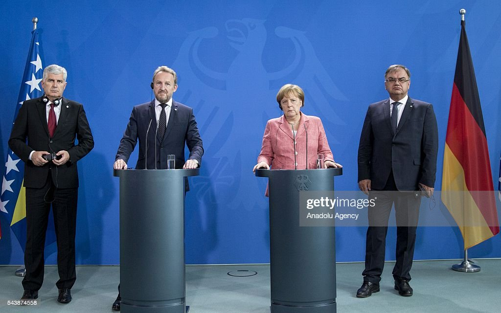 German Chancellor Angela Merkel (2nd R) Bosniak Member of the Presidency of Bosnia and Herzegovina Bakir Izetbegovic (2nd L), Serbian Member of the Presidency of Bosnia and Herzegovina Mladen Ivanic (R) and Croat Member of the Presidency of Bosnia and Herzegovina Dragan Covic (L) hold a joint press conference following their meeting at the Federal Chancellery in Berlin, Germany on June 30, 2016.