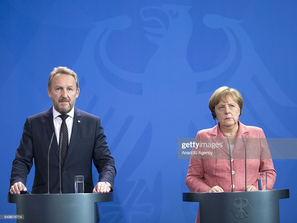 German Chancellor Angela Merkel (R) Bosniak Member of the Presidency of Bosnia and Herzegovina Bakir Izetbegovic (L), Serbian Member of the Presidency of Bosnia and Herzegovina Mladen Ivanic (not seen) and Croat Member of the Presidency of Bosnia and Herzegovina Dragan Covic (not seen) hold a joint press conference following their meeting at the Federal Chancellery in Berlin, Germany on June 30, 2016.