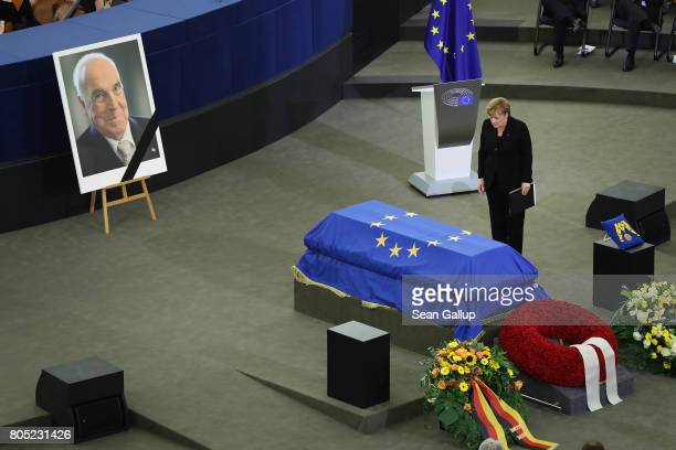 German Chancellor Angela Merkel bows at the coffin of former German Chancellor Helmut Kohl after she spoke at a memorial ceremony for Kohl at the...