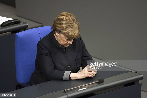 German Chancellor Angela Merkel bows her head during a commemoration at Bundestag on January 19 2017 in Berlin GermanyOn December 19 2016 Anis Amri a...