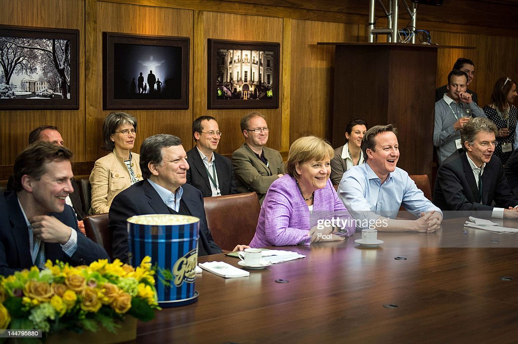 German Chancellor <a gi-track='captionPersonalityLinkClicked' href=/galleries/search?phrase=Angela+Merkel&family=editorial&specificpeople=202161 ng-click='$event.stopPropagation()'>Angela Merkel</a>, British Prime Minister <a gi-track='captionPersonalityLinkClicked' href=/galleries/search?phrase=David+Cameron+-+Pol%C3%ADtico&family=editorial&specificpeople=227076 ng-click='$event.stopPropagation()'>David Cameron</a> and EU Commission President Jose Manuel Barroso watch the UEFA Champions League Final between FC Bayern Muenchen and Chelsea FC during the 2012 G8 Summit at Camp David on May 19, 2012 in Camp David, Maryland. Leaders of eight of the worlds largest economies are meeting over the weekend in an effort to keep the lingering European debt crisis from spinning out of control.