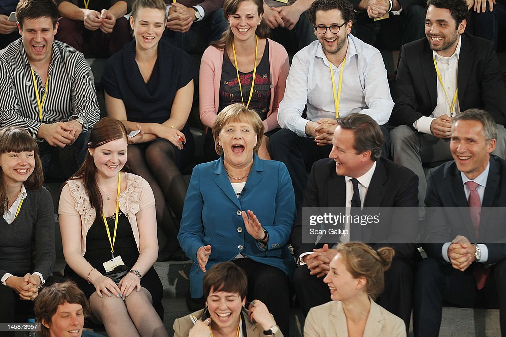 German Chancellor <a gi-track='captionPersonalityLinkClicked' href=/galleries/search?phrase=Angela+Merkel&family=editorial&specificpeople=202161 ng-click='$event.stopPropagation()'>Angela Merkel</a> (C), British Prime Minister <a gi-track='captionPersonalityLinkClicked' href=/galleries/search?phrase=David+Cameron+-+Politician&family=editorial&specificpeople=227076 ng-click='$event.stopPropagation()'>David Cameron</a> (2nd row, 2nd from R) and Norwegian Prime Minister <a gi-track='captionPersonalityLinkClicked' href=/galleries/search?phrase=Jens+Stoltenberg&family=editorial&specificpeople=558620 ng-click='$event.stopPropagation()'>Jens Stoltenberg</a> (2nd row, R) meet with students at the Chancellery on June 7, 2012 in Berlin, Germany. The three leaders participated in a televised panel discussion of 100 students about the future of Germany. Merkel and Cameron were likely to also discuss the current European debt crisis.