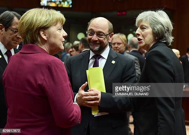 German Chancellor Angela Merkel British Prime Minister Theresa May and European Parliament President Martin Schulz speak together ahead of European...