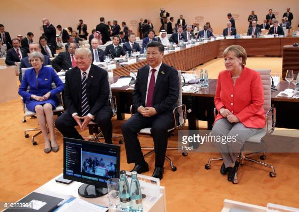 German Chancellor Angela Merkel British Prime Minister Theresa May US President Donald Trump and Chinese President Xi Jinping at the first session of...