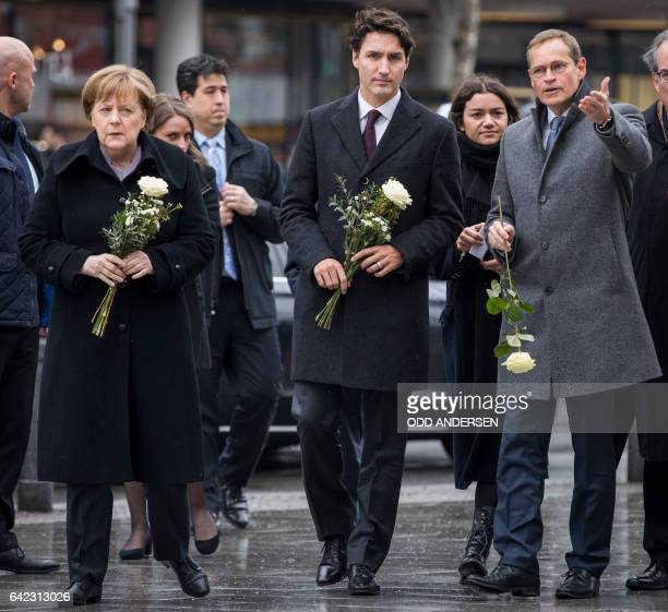 German Chancellor Angela Merkel Canadian prime minister Justin Trudeau and Berlin's mayor Michael Mueller arrive to lay down flowers at a memorial to...