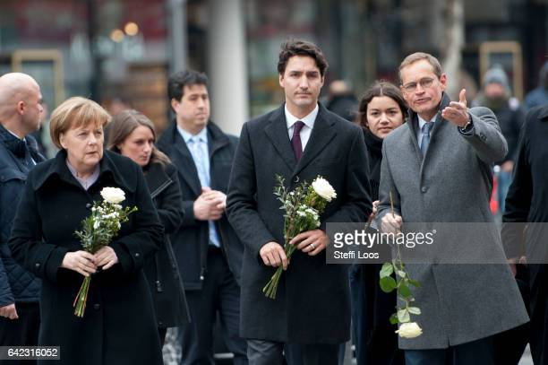 German Chancellor Angela Merkel Canadian Prime Minister Justin Trudeau and Mayor of Berlin Michael Mueller prepare to lay flowers at a memorial to...