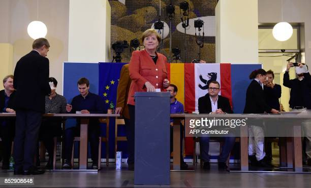 German Chancellor Angela Merkel casts her vote at a polling station in Berlin during general elections on September 24 2017 Polls opened in Germany...