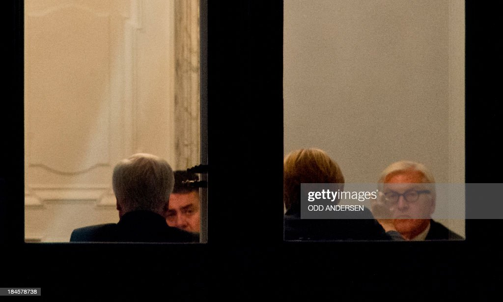 German Chancellor Angela Merkel, CDU (2nd R) gestures during a meeting with Social Democratic Party (SPD) leader Sigmar Gabriel (2nd L), SPD's faction-leader Frank-Walter Steinmeier (R) and Bavarian State Premier Horst Seehofer of the Christian Social Union (CSU), at the Jakob Kaisers haus at the German parliament during the 2nd round of exploratory talks on forming a coalition government in Berlin on October 14, 2013. The exploratory talks with the left-leaning ecologist party are part of Merkel's hunt for a governing partner after her conservatives won September 22 elections but fell short of a ruling majority.