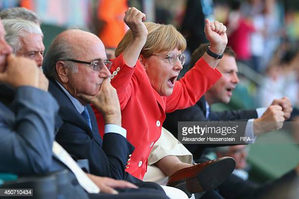 German Chancellor Angela Merkel celebrates Germany's 4th goal during the 2014 FIFA World Cup Brazil Group G match between Germany and Portugal at...