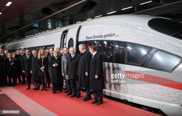 German Chancellor Angela Merkel Chairman of German railway operator Deutsche Bahn Richard Lutz and other guests stand in front of an ICE high speed...