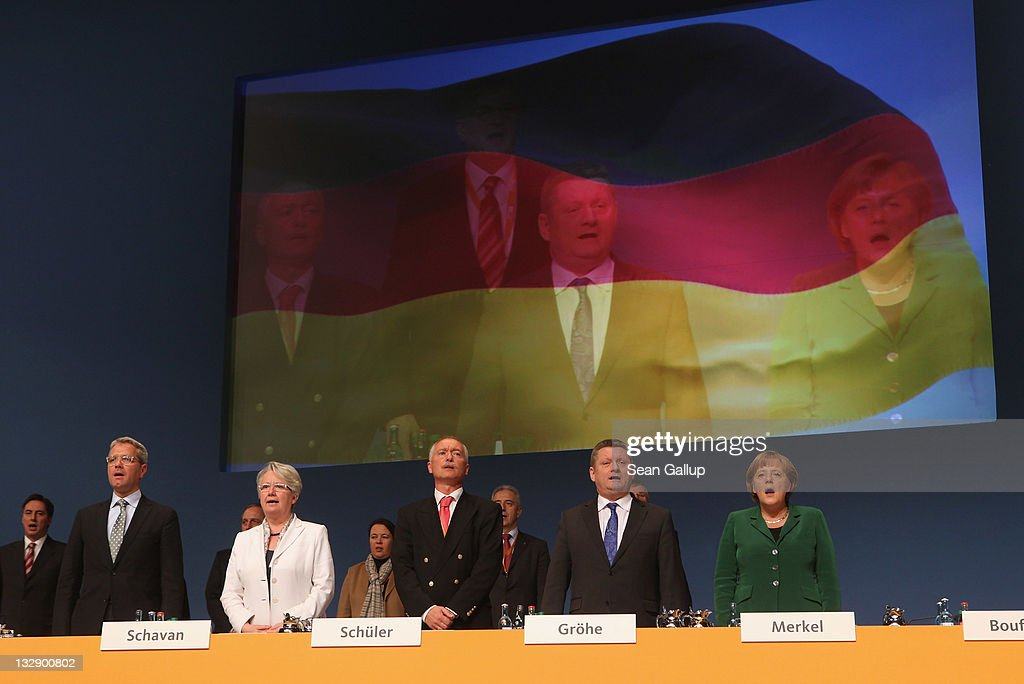 German Chancellor Angela Merkel (R), Chairwoman of the German Christian Democrats (CDU), and other leading CDU members, including General Secretary Hermann Groehe (2nd from R), Environment Minister Norbert Roettgen (L) and Education Minister Annette Schavan (2nd from L), sing the national anthem at the conclusion of the 24th CDU Party Congress on November 15, 2011 in Leipzig, Germany. High on the morning's agenda was discussion of a proposal to reform Germany's primary education system.