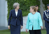 German Chancellor Angela Merkel chats with British Prime Minister Theresa May upon May's arrival at the Chancellery on July 20 2016 in Berlin Germany...