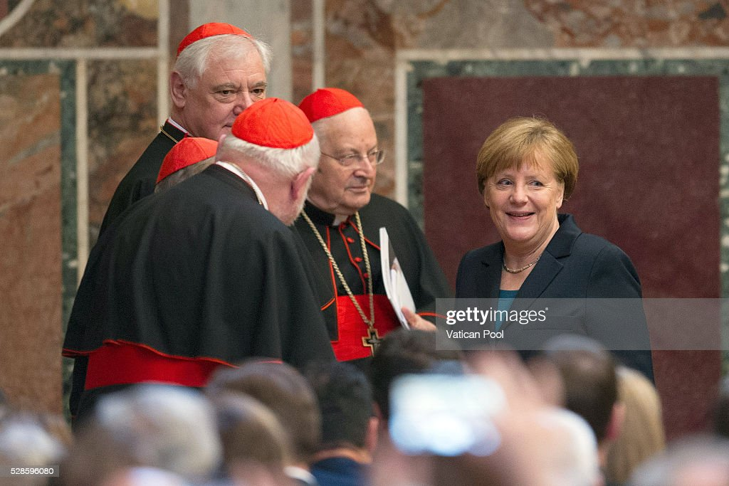 German Chancellor Angela Merkel chats with cardinals Gerhard Ludwig Muller; <a gi-track='captionPersonalityLinkClicked' href=/galleries/search?phrase=Reinhard+Marx&family=editorial&specificpeople=4687697 ng-click='$event.stopPropagation()'>Reinhard Marx</a>, Walter Kasper and Angelo Sodano during the Charlemagne Prize of Aachen ceremony at the Reggia Hall on May 6, 2016 in Vatican City, Vatican. The International Charlemagne Prize of Aachen is the oldest and best-known prize awarded for work done in the service of European unification.