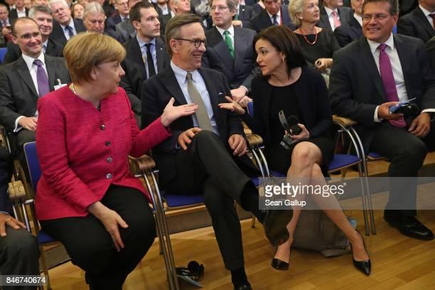 German Chancellor Angela Merkel chats with Facebook Chief Operating Officer Sheryl Sandberg as Matthias Wissmann President of the German Automobile...