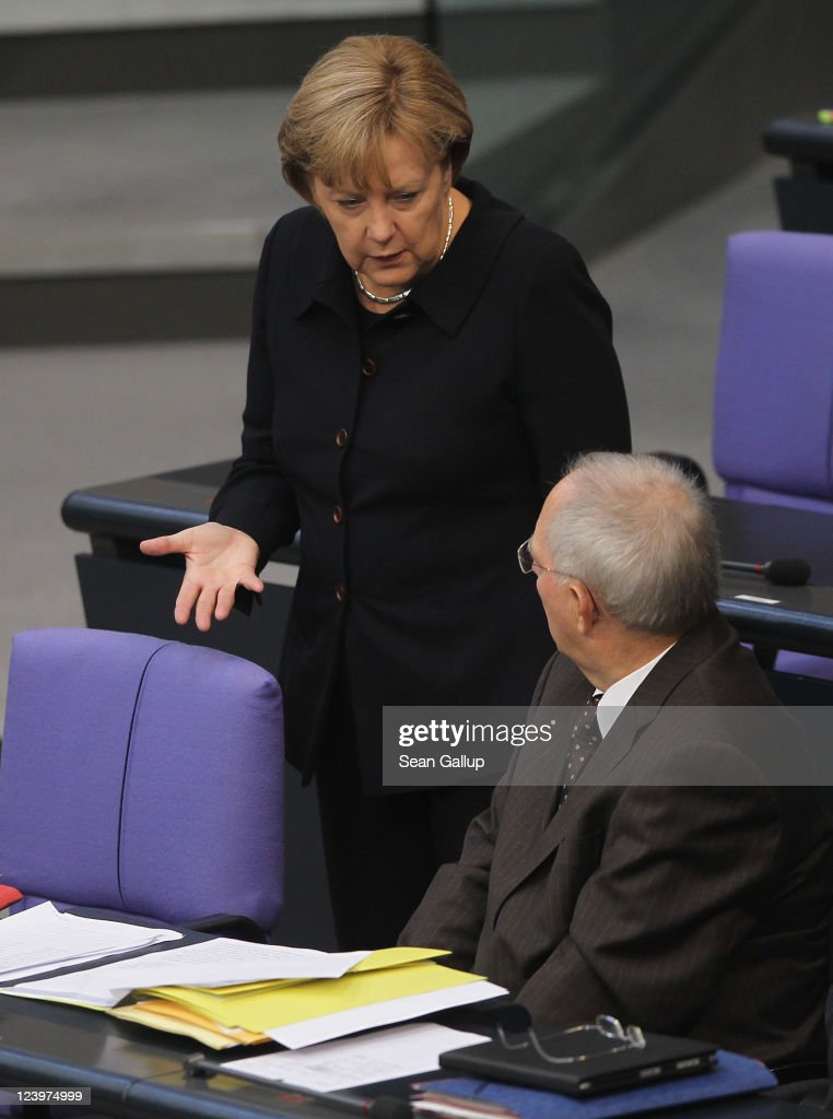 German Chancellor <a gi-track='captionPersonalityLinkClicked' href=/galleries/search?phrase=Angela+Merkel&family=editorial&specificpeople=202161 ng-click='$event.stopPropagation()'>Angela Merkel</a> chats with Finance Minister Wolfgang Schaeuble during debates over the federal budget at the Bundestag on September 7, 2011 in Berlin, Germany. Merkel was scheduled to give a speech later in the day where she is expected to further argue for an extension of the EFSF, the European mechanism for helping European Union meber states in times of financial crisis. Many critics argue against the move, claiming it will only expose Germany more to the debt problems of other states, like Greece, without ensuring Eurozone stability.