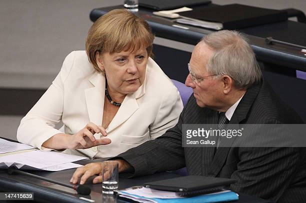 German Chancellor Angela Merkel chats with Finance Minister Wolfgang Schaeuble during debates pior to a vote in the Bundestag on Germany's...