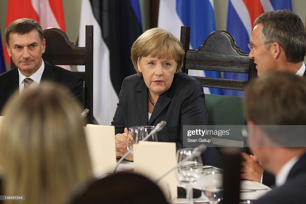 German Chancellor <a gi-track='captionPersonalityLinkClicked' href=/galleries/search?phrase=Angela+Merkel&family=editorial&specificpeople=202161 ng-click='$event.stopPropagation()'>Angela Merkel</a> chats with guests as Estonian Prime Minister <a gi-track='captionPersonalityLinkClicked' href=/galleries/search?phrase=Andrus+Ansip&family=editorial&specificpeople=566399 ng-click='$event.stopPropagation()'>Andrus Ansip</a> (L) looks on at the dinner of the 2012 Council of Baltic Sea States Summit on May 30, 2012 in Stralsund, Germany. Leaders of the eleven member states as well as representatives of the European Union are meeting to discuss matters related to energy, the environment and economic development during the two-day summit.