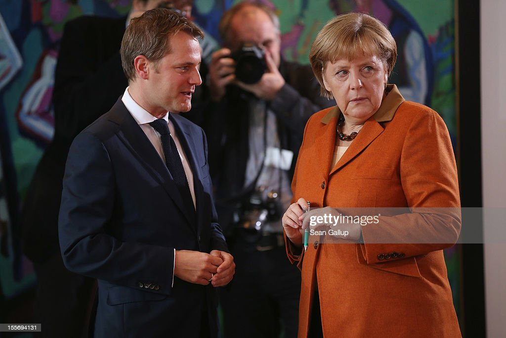 German Chancellor <a gi-track='captionPersonalityLinkClicked' href=/galleries/search?phrase=Angela+Merkel&family=editorial&specificpeople=202161 ng-click='$event.stopPropagation()'>Angela Merkel</a> chats with Health Minister <a gi-track='captionPersonalityLinkClicked' href=/galleries/search?phrase=Daniel+Bahr&family=editorial&specificpeople=7622444 ng-click='$event.stopPropagation()'>Daniel Bahr</a> prior to the weekly German government cabinet meeting on November 7, 2012 in Berlin, Germany. Bahr recently agreed to scrap the EUR 10 per quarter health treatment fee, known in Germany as the Praxisgebuehr, which critics charged did little to stem the volume of patients received by doctors and no longer made financial sense, given the surging profits of Germany's public health insurers.