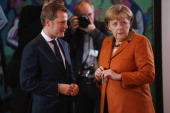 German Chancellor Angela Merkel chats with Health Minister Daniel Bahr prior to the weekly German government cabinet meeting on November 7 2012 in...