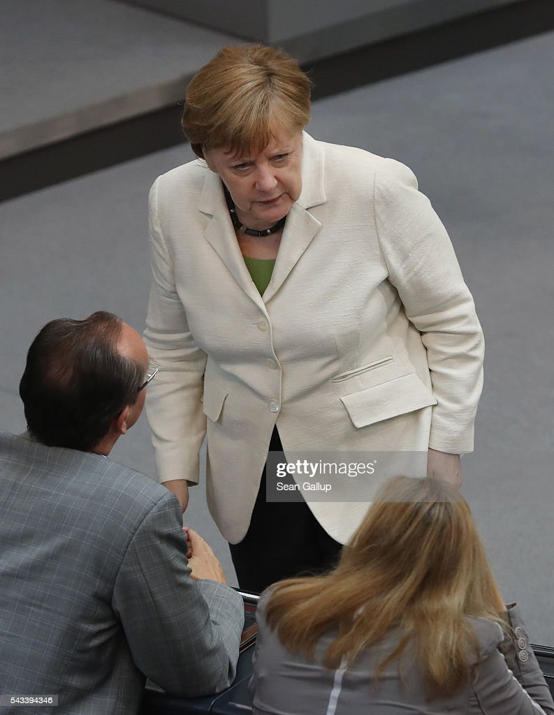 German Chancellor <a gi-track='captionPersonalityLinkClicked' href=/galleries/search?phrase=Angela+Merkel&family=editorial&specificpeople=202161 ng-click='$event.stopPropagation()'>Angela Merkel</a> chats with paliamentarians after she addressed the Bundestag with a government declaration on the recent Brexit vote on June 28, 2016 in Berlin, Germany. European leaders are scheduled to meet at a summit in Brussels later today to discuss the consequences of the British vote to leave the European Union. Merkel called the vote an unprecedented event in EU history but one the remaining 27 member states will weather.