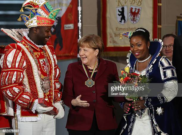 German Chancellor Angela Merkel chats with Prince Samuel and Princess Jacinta from Ratingen in North RhineWestphalia during the annual Carnival...