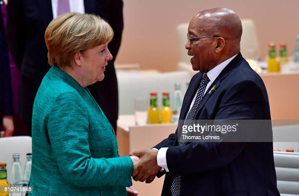 German Chancellor Angela Merkel chats with South African President Jacob Zuma at the morning working session on the second day of the G20 economic...