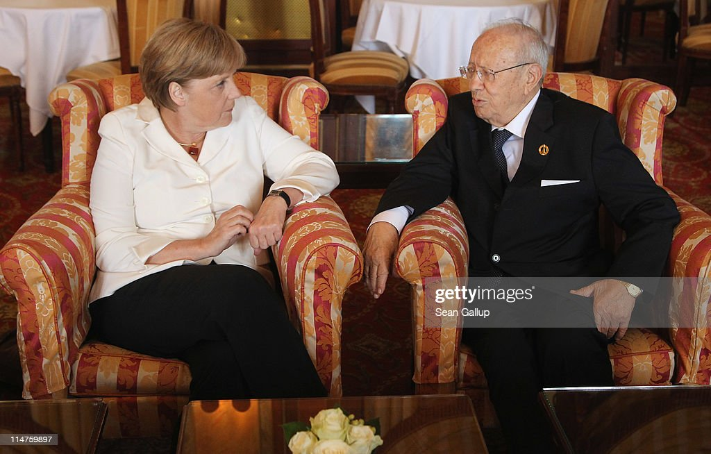 German Chancellor Angela Merkel chats with Tunisian Prime Minister Beji Caid Essebsi during a bilateral meeting at the G8 Summit on May 26, 2011 in Deauville, France. France is hosting the G8 Summit, which focuses on issues including African development, the Arab Spring and the Internet.