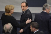 German Chancellor Angela Merkel cheers French President Francois Hollande during the joint session of the French National Assembly and the Bundestag...