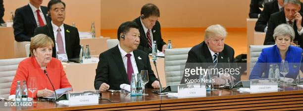 German Chancellor Angela Merkel Chinese President Xi Jinping US President Donald Trump and British Prime Minister Theresa May attend a Group of 20...