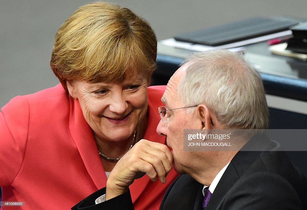 German Chancellor Angela Merkel confer with finance minister Wolfgang Schaeuble during a debate in the Bundestag the German lower house of parliament...