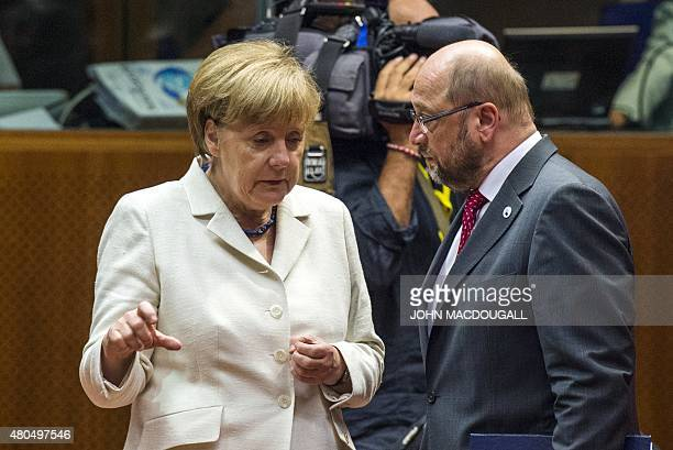 German Chancellor Angela Merkel confers with European Parliament President Martin Schulz prior to the start of a Eurozone summit in Brussel on July...