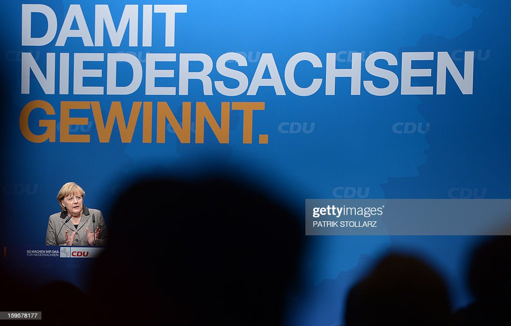 German Chancellor Angela Merkel delievers a speech during an election campaign event of the regional Christian Democratic Union (CDU) party for 2013 state elections in Osnabrueck, northern Germany, on January 16, 2013. AFP PHOTO / PATRIK STOLLARZ