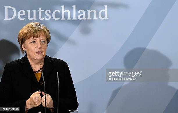 German Chancellor Angela Merkel delivers a speech during a reception to mark the 60th anniversary of migrant workers in Germany in Berlin on December...