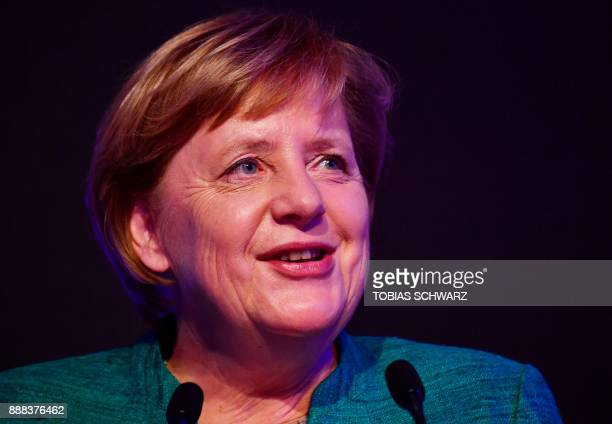 German Chancellor Angela Merkel delivers a speech during the inauguration ceremony of a special ICE high speed train at the railway station in Berlin...