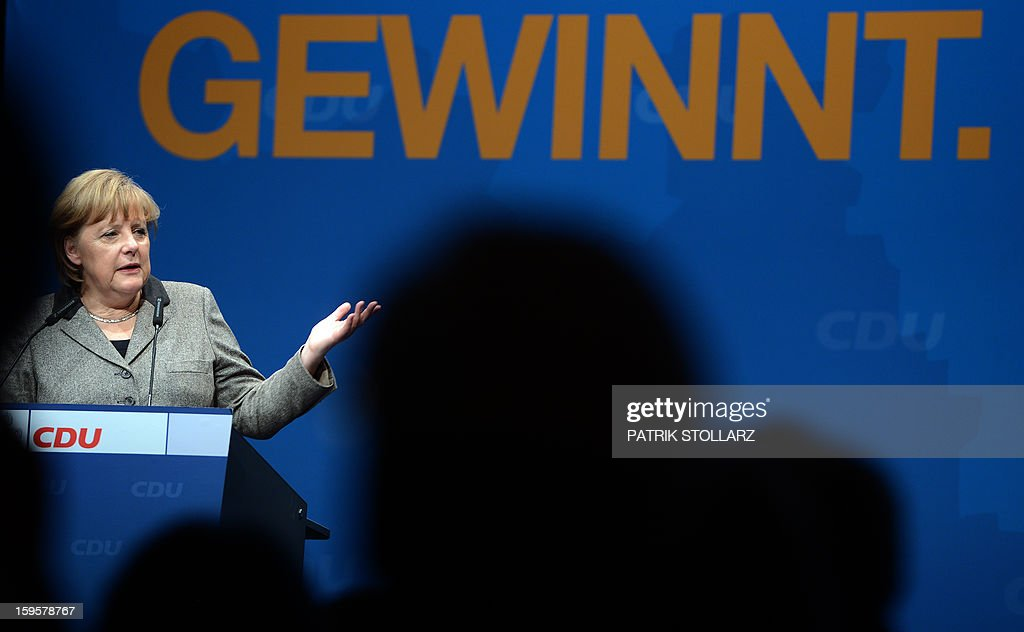 German Chancellor Angela Merkel delivers a speech in front of a placard saying 'that Lower-Saxony wins' during an election campaign event of the regional Christian Democratic Union (CDU) party for the 2013 state elections in Osnabrueck, northern Germany, on January 16, 2013. AFP PHOTO / PATRIK STOLLARZ