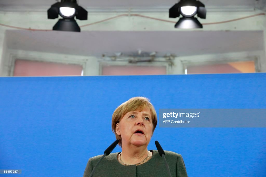 German Chancellor Angela Merkel delivers a statement on the Barcelona attack in Berlin, on August 18, 2017. In the Barcelona incident, claimed by the Islamic State group, a white van sped down a wide avenue packed full of tourists on August 17, 2017 afternoon, knocking people down and killing 13 in a scene of chaos and horror. / AFP PHOTO / Odd ANDERSEN