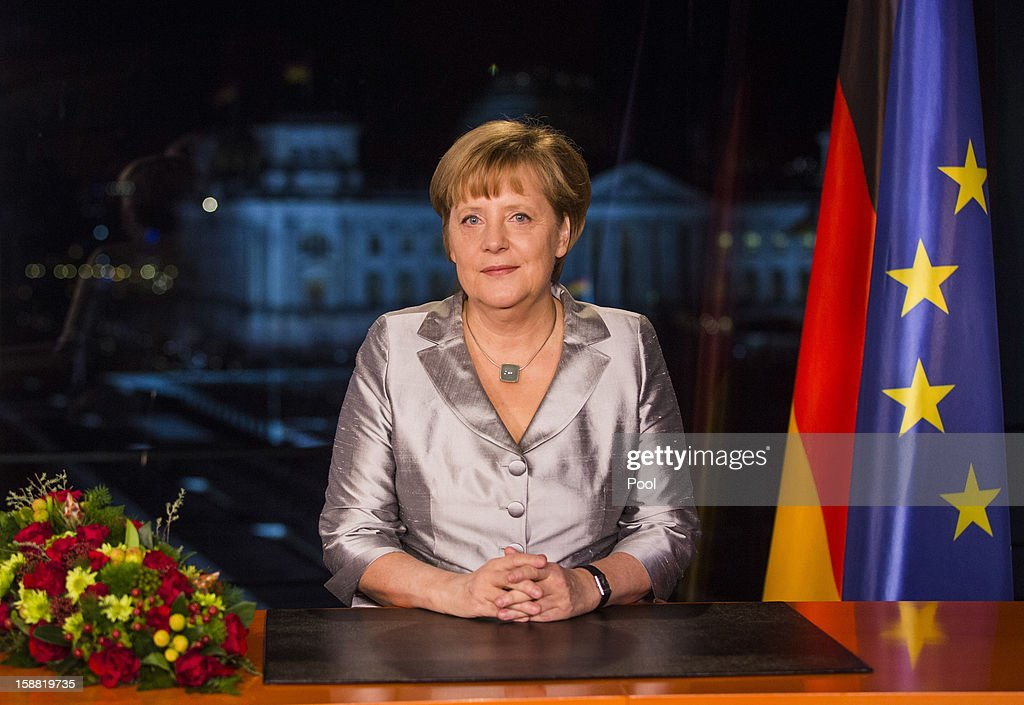 German Chancellor <a gi-track='captionPersonalityLinkClicked' href=/galleries/search?phrase=Angela+Merkel&family=editorial&specificpeople=202161 ng-click='$event.stopPropagation()'>Angela Merkel</a> delivers her New Year's speech on December 30, 2012 in Berlin, Germany.
