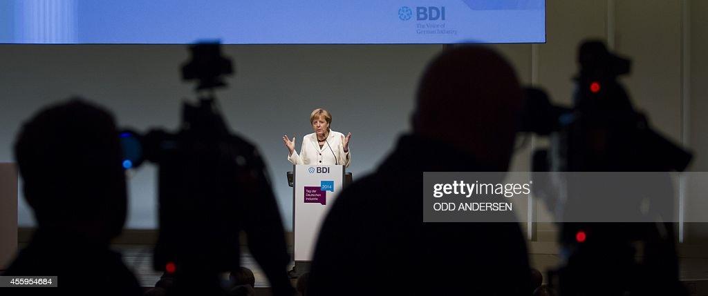 German Chancellor Angela Merkel delivers her speech at the Federation of German Industries annual congress in Berlin on September 23 2014 Merkel...