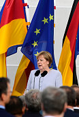 German Chancellor Angela Merkel delivers her speech to foreign diplomatic representatives during the annual meeting at Meseberg Palace near Berlin on...