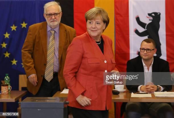 German Chancellor Angela Merkel departs after casting her ballot in German federal elections on September 24 2017 in Berlin Germany Merkel is seeking...