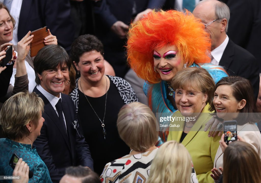 German Chancellor Angela Merkel (R), drag queen Olivia Jones and German football coach Joachim Loew (L) attend the election of the new president of Germany by the Federal Assembly at the Reichstag on February 12, 2017 in Berlin, Germany. Frank-Walter Steinmeier, a German Social Democrat (SPD), is Germany's former foreign minister and is likely to win. He will succeed outgoing German president Joachim Gauck.