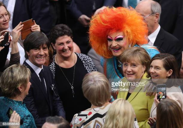 German Chancellor Angela Merkel drag queen Olivia Jones and German football coach Joachim Loew attend the election of the new president of Germany by...